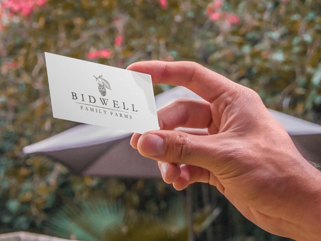 holding-business-card-on-backyard-7836